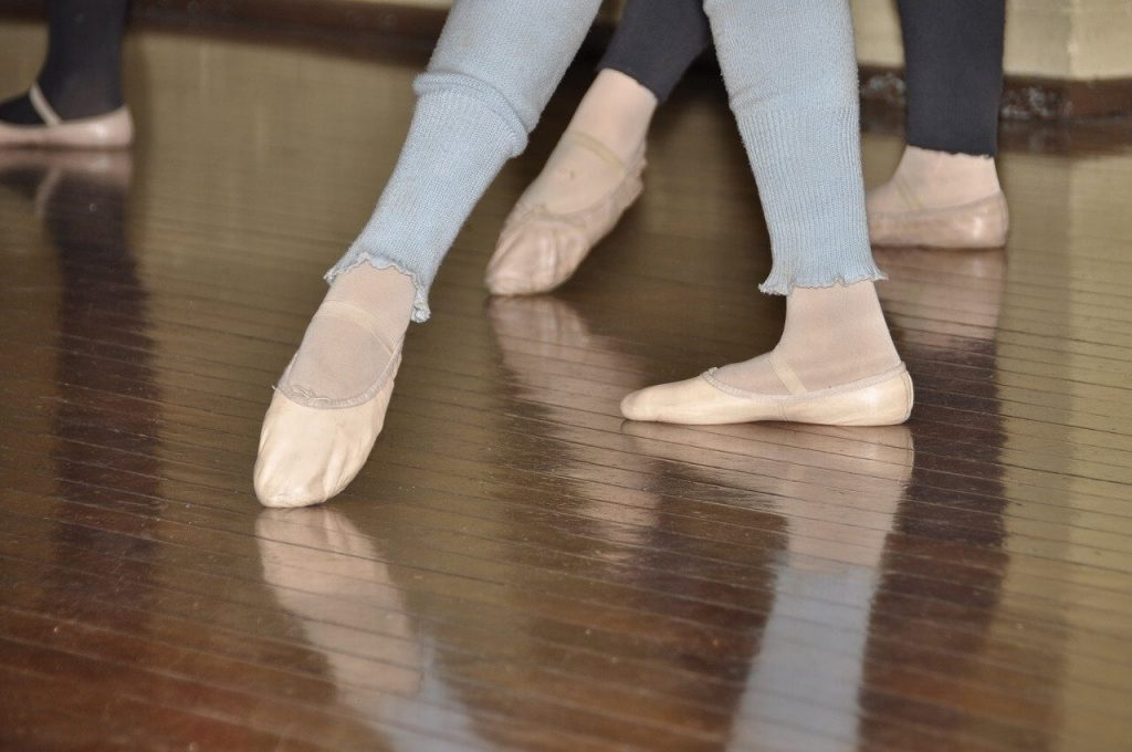 Wearing ballet shoes in a ballet class